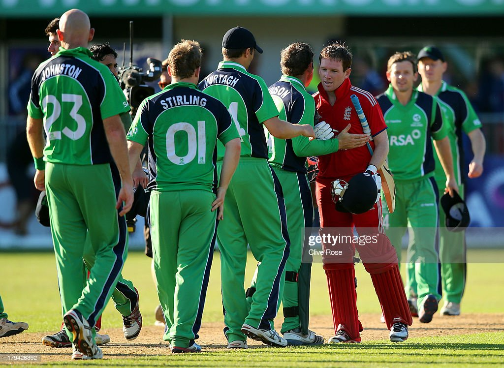Eoin Morgan of England is congratulated by the Irish team after hitting the winning runs in the RSA Challenge One Day International match between Ireland and England on September 3, 2013 in Malahide, Ireland.