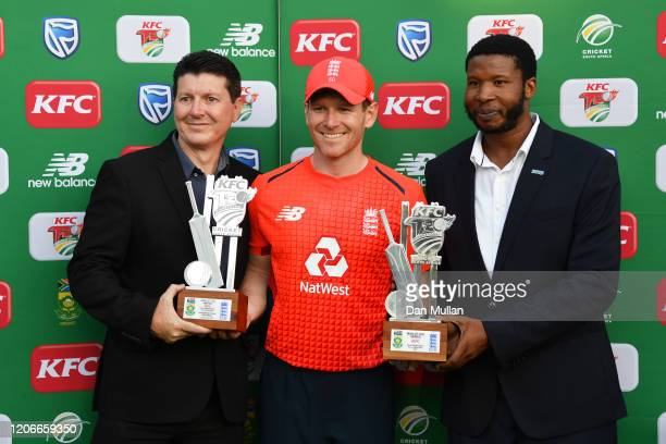 Eoin Morgan of England is presented with the Player of the Match and Player of the Series Awards during the Third T20 International match between...