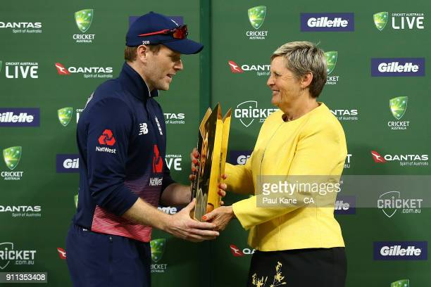 Eoin Morgan of England is presented with the series trophy by WACA CEO Christina Matthews during game five of the One Day International match between...