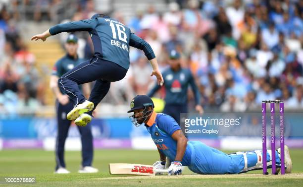 Eoin Morgan of England jumps to avoid Shikhar Dhawan of India during the 3rd Royal London OneDay International match between England and India at...