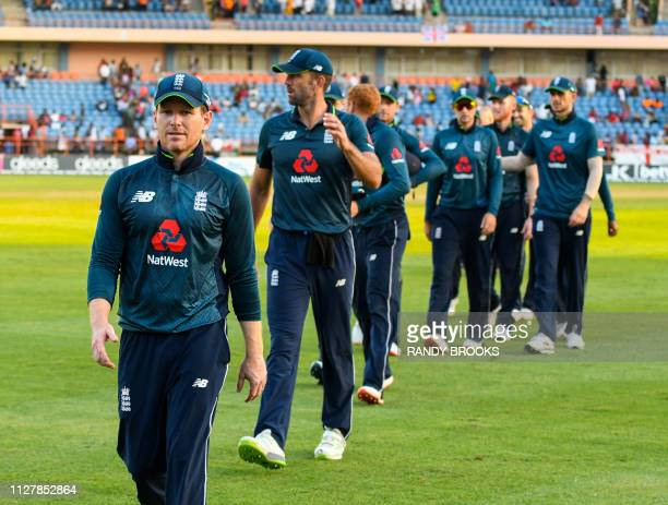 Eoin Morgan of England leads the team off the field after winning the 4th ODI between West Indies and England at Grenada National Cricket Stadium...