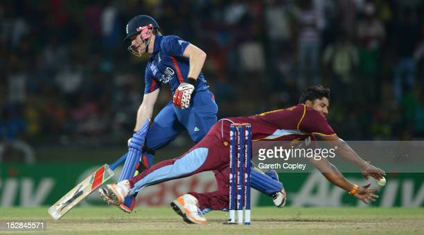 Eoin Morgan of England makes his ground underpressure from Ravi Rampaul of the West Indies during the ICC World Twenty20 2012 Super Eights Group 1...