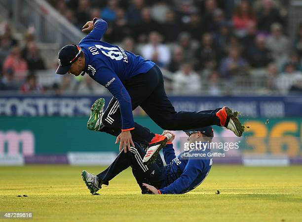 Eoin Morgan of England narrowly avoids Jason Roy as he catches Joe Burns of Australia during the 3rd Royal London OneDay International match between...