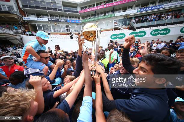 Eoin Morgan of England parades the trophy with fans during the England ICC World Cup Victory Celebration at The Kia Oval on July 15, 2019 in London,...