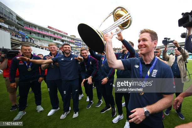 Eoin Morgan of England parades the trophy with young fans during the England ICC World Cup Victory Celebration at The Kia Oval on July 15, 2019 in...