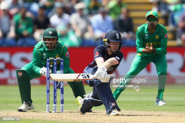 Eoin Morgan of England plays a reverse sweep off the bowling of Shadab Khan as wicketkeeper Sarfraz Ahmed looks on during the ICC Champions Trophy...