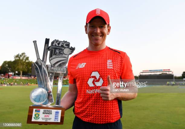 Eoin Morgan of England poses for a photo with the series trophy after the Third T20 International match between South Africa and England at...