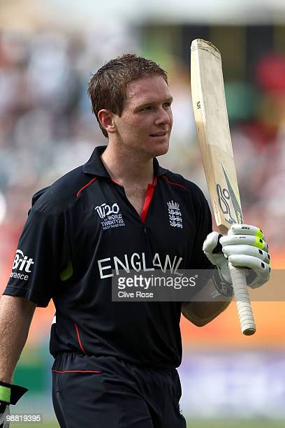 Eoin Morgan of England raises his bat as he leaves the field during the ICC T20 World Cup Group D match between West Indies and England at the Guyana...