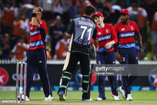 Eoin Morgan of England shakes hands with Colin de Grandhomme of the Black Caps after winning the International Twenty20 match between New Zealand and...