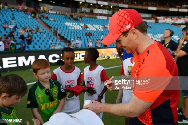 Eoin Morgan of England signs autographs for young fans following the Third T20 International match between South Africa and England at SuperSport...