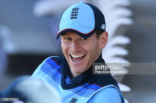 Eoin Morgan of England smiles as the England openers bat during the first Royal London One Day International against Ireland at Ageas Bowl on July 30...