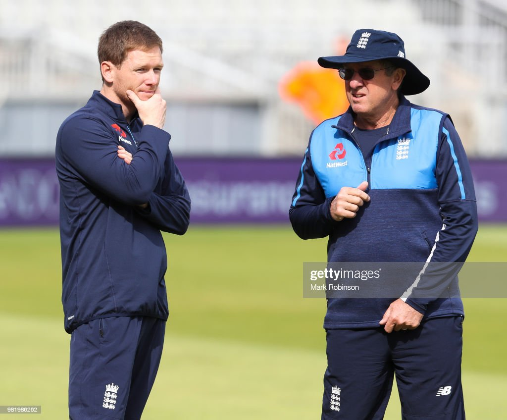 Eoin Morgan of England speaks to head coach Trevor Bayliss during a nets session at Old Trafford on June 23, 2018 in Manchester, England.