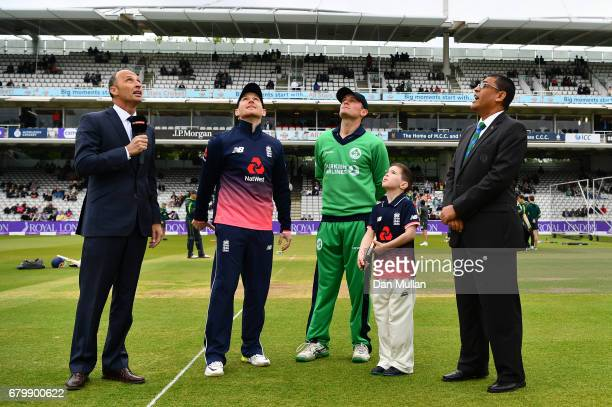 Eoin Morgan of England tosses the coin alongside William Porterfield of Ireland prior to the Royal London One Day International between England and...