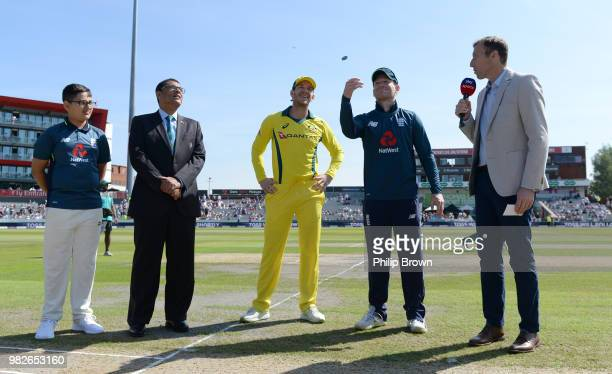 Eoin Morgan of England tosses the coin watched by Tim Paine of Australia before the fifth Royal London OneDay International match between England and...