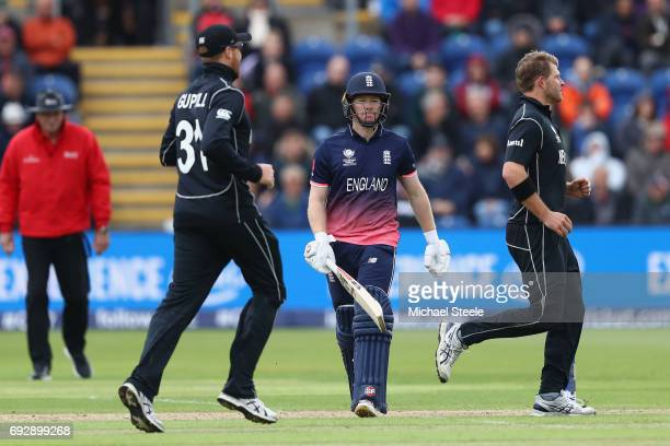 Eoin Morgan of England walks after being caught behind by Luke Ronchi off the bowling of Corey Anderson of New Zealand during the ICC Champions...