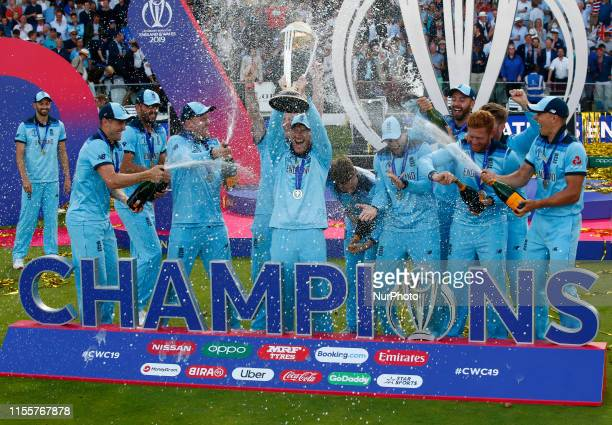 Eoin Morgan of England with Trophy during ICC Cricket World Cup Final between England and New Zealand at the Lord's Cricket Ground on July 14 2019 in...