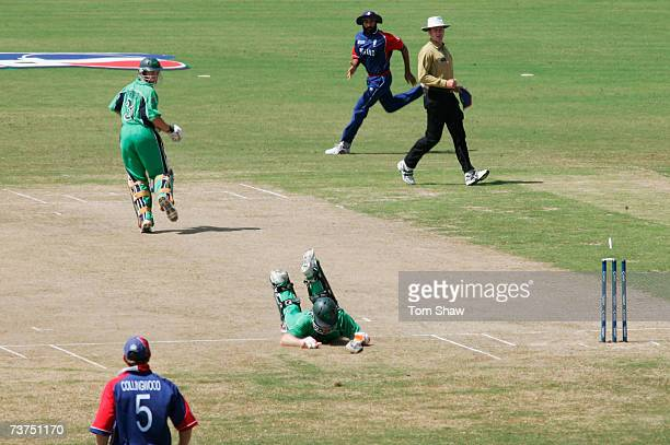 Eoin Morgan of Ireland is run out by Sajid Mahmood of England during the ICC Cricket World Cup Super Eights match between England and Ireland at the...