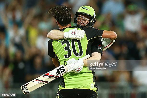 Eoin Morgan of the Thunder and Pat Cummins of the Thunder celebrate victory after winning the Big Bash League match between the Sydney Thunder and...