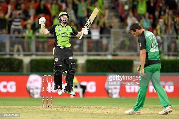 Eoin Morgan of the Thunder celebrates hitting a six to win the match during the Big Bash League match between the Sydney Thunder and Melbourne Stars...