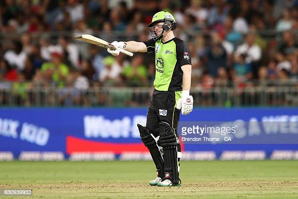 Eoin Morgan of the Thunder celebrates scoring his half century during the Big Bash League match between the Sydney Thunder and Melbourne Stars at...