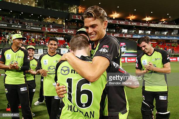 Eoin Morgan of the Thunder celebrates with team mate Chris Green after hitting a six off the last ball for victory over the Stars during the Big Bash...