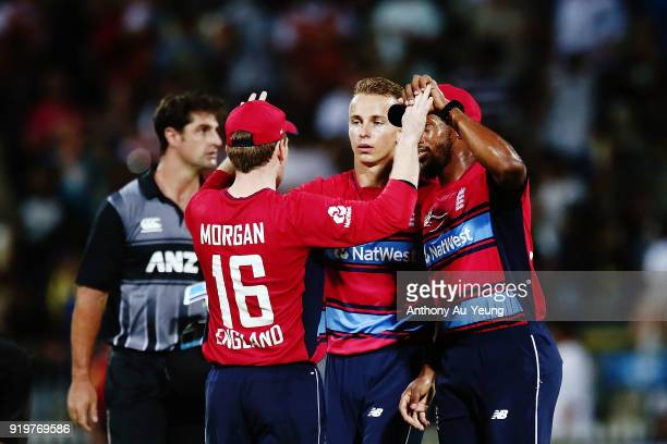 Eoin Morgan Tom Curran and Chris Jordan of England celebrate after winning the International Twenty20 match between New Zealand and England at Seddon...