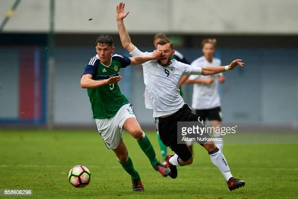 Eoin Toal of U19 Northern Ireland fights for the ball with Manuel Wintzheimer of U19 Germany during soccer match U19 Germany v U19 Northern Ireland...