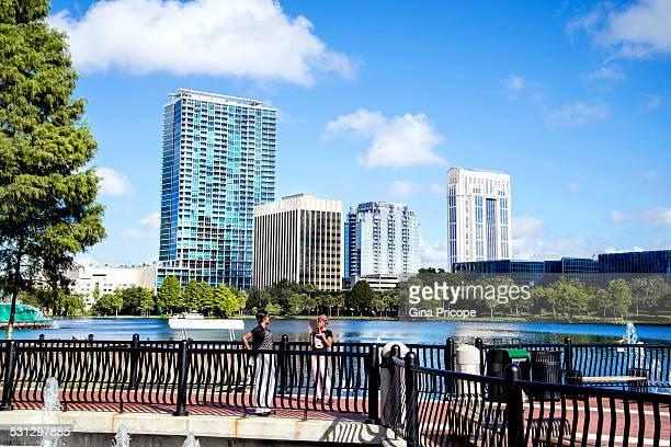 eola lake park in downtown orlando - orlando florida stock photos and pictures