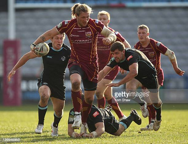 Eorl Crabtree of Huddersfield evades a tackle during the Super League match between London Broncos and Huddersfield Giants at Twickenham Stoop on...