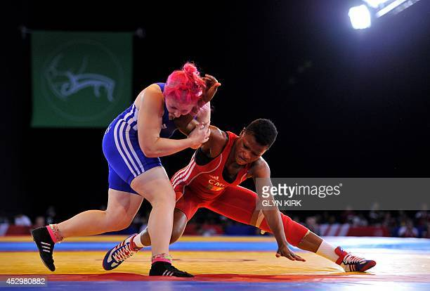 Epanga Metala of Cameroon grapples with Sarah Connolly of Wales in the Women's Freestyle 63kg Freestyle Wrestling Bronze medal match at the SECC 2014...