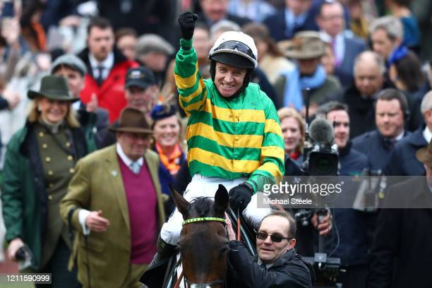 Epatante ridden by Barry Geraghty celebrate winning the Unibet Champion Hurdle Challenge Trophy at Cheltenham Racecourse on March 10, 2020 in...