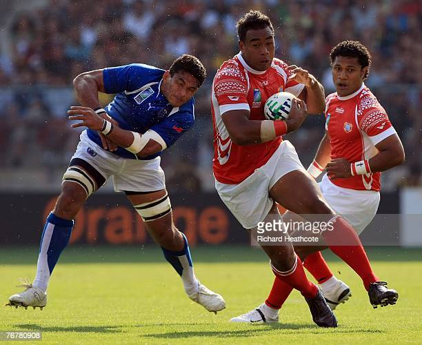 Epeli Taione of Tonga avoids the tacke by Semo Sititi of Samoa during match eighteen of the Rugby World Cup 2007 between Samoa and Tonga at the Stade...