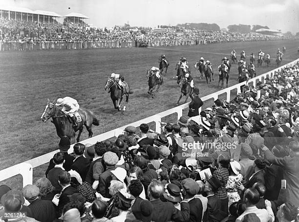 Eph Smith on 'Blue Peter' winning from 'Fox Club' ridden by Gordon Richards with Heliopolis in third place at the Derby at Epsom