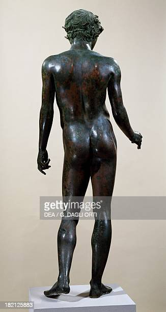 Ephebos crowned with ivy bronze statue unearthed in Volubilis Morocco seen from the back Roman Civilisation end of 1st century BC early 1st century...