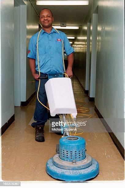 Ephraim in apt hallway with a floor polisher