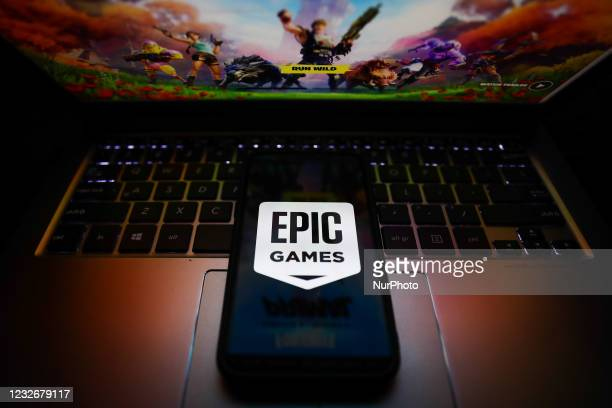 Epic Games logo is seen displayed on a phone screen in this illustration photo taken in Krakow, Poland on May 3, 2021.