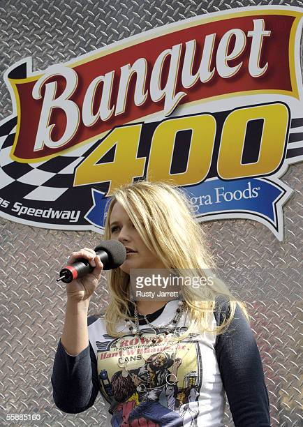 Epic recording artist Amanda Lambert sings the national anthem prior to the NASCAR Nextel Cup Series Banquet 400 on October 9, 2005 at the Kansas...