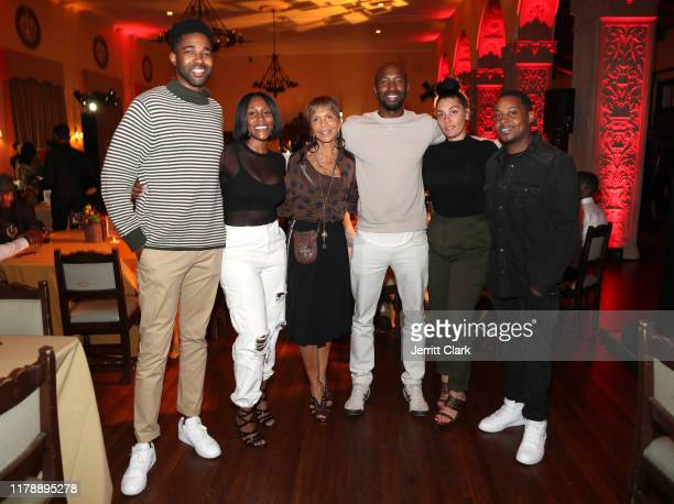 Epic Records Executives Maurice Slade Ericka Coulter Sylvia Rhone Ezekiel Lewis Jennifer Goicoechea and Courtney Lowery attend the NILC Courageous...