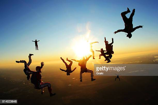 Epic skydivers at the sunset