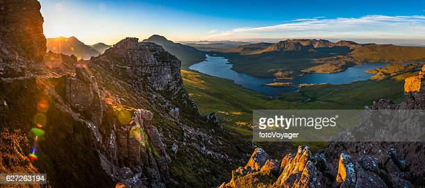 epic sunrise over highland peaks glens lochs wilderness panorama scotland - schotland stockfoto's en -beelden