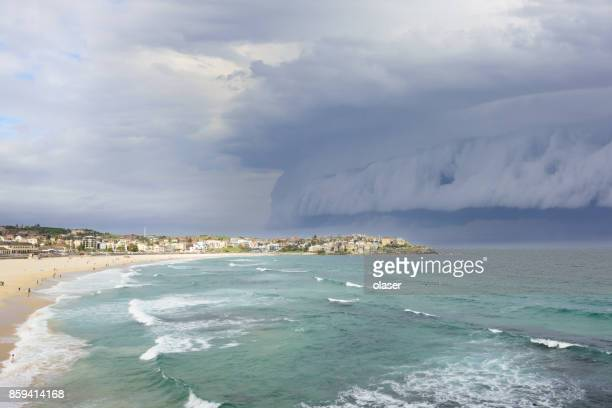 epic supercell shelf cloud over bondi beach - sydney rain stock pictures, royalty-free photos & images