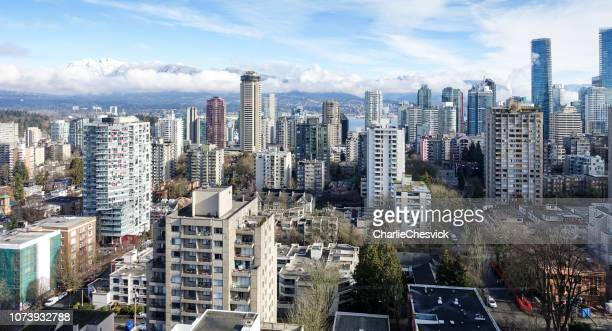 epic view from skyscraper on vancouver downtown and mountains (cypress) behind - vancouver stock pictures, royalty-free photos & images