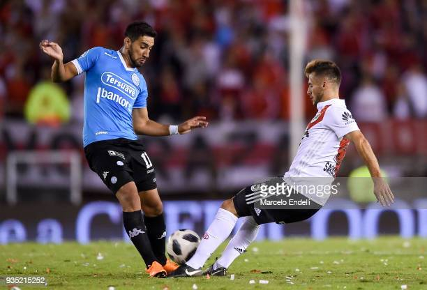 Epifanio Garcia of Belgrano fights for ball with Marcelo Saracchi of River Plate during a match between River Plate and Belgrano as part of Superliga...