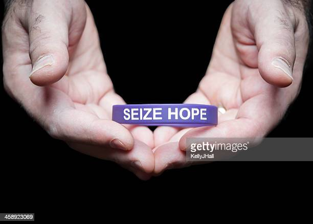 epilepsy foundation cincinnati chapter purple seize hope bracelet - epilepsy stock pictures, royalty-free photos & images