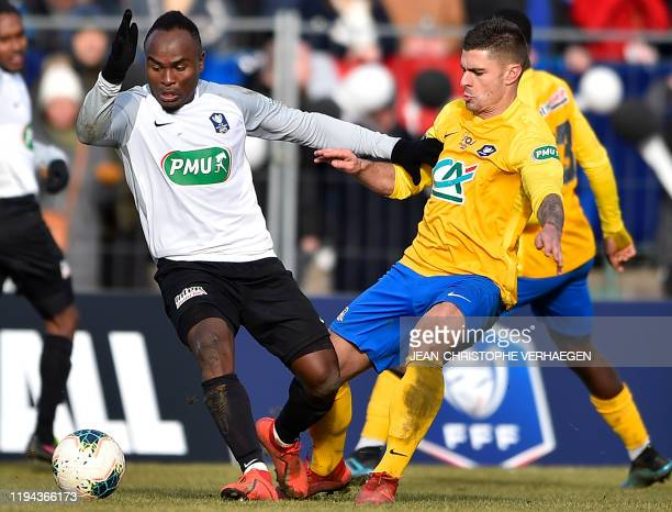 Epinal's defender JeremyColin vies with SaintPierroise's defender Pascal Razakanantenaina during the French Cup football match between Epinal and...