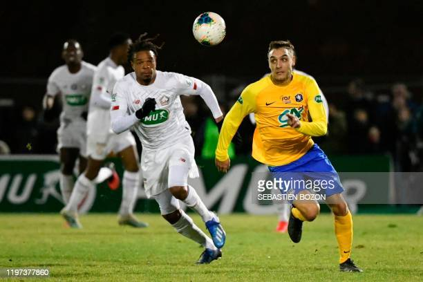 Epinal's French defender Paul Leonard vies with Lille's French forward Loic Remy during the French Cup roundof16 football match between Epinal and...