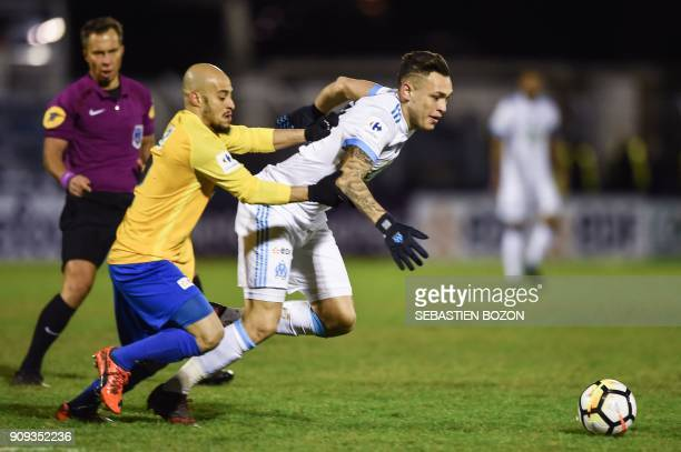 Epinal's French defender Rafael Mazzei vies with Olympique de Marseille's Argentinian forward Lucas Ocampos during the French Cup round of 32...
