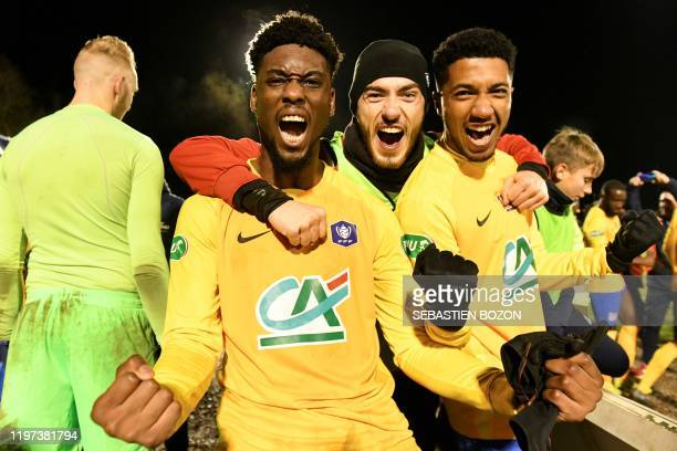 Epinal's French forward JeanPhilippe Krasso and teammates celebrate their team's win at the end of the French Cup roundof16 football match between...