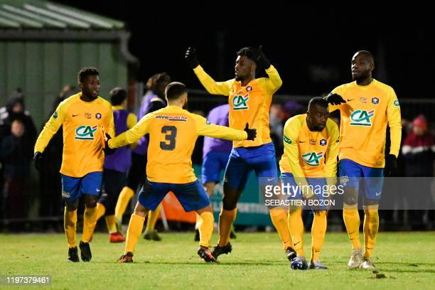 Epinal's French forward JeanPhilippe Krasso jubilates after scoring his team's second goal during the French Cup roundof16 football match between...