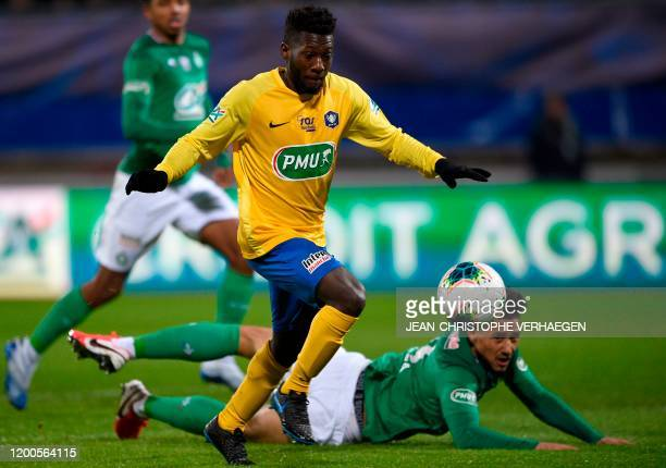 Epinal's French forward Mickael Biron vies with Saint-Etienne's French defender William Saliba during the French Cup quarter-final football match...